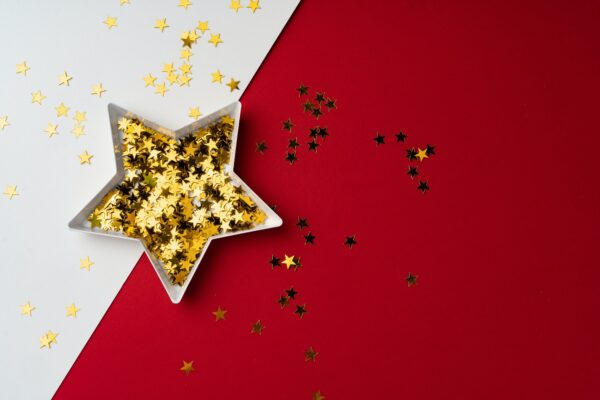 Star shaped plate with golden confetti top view